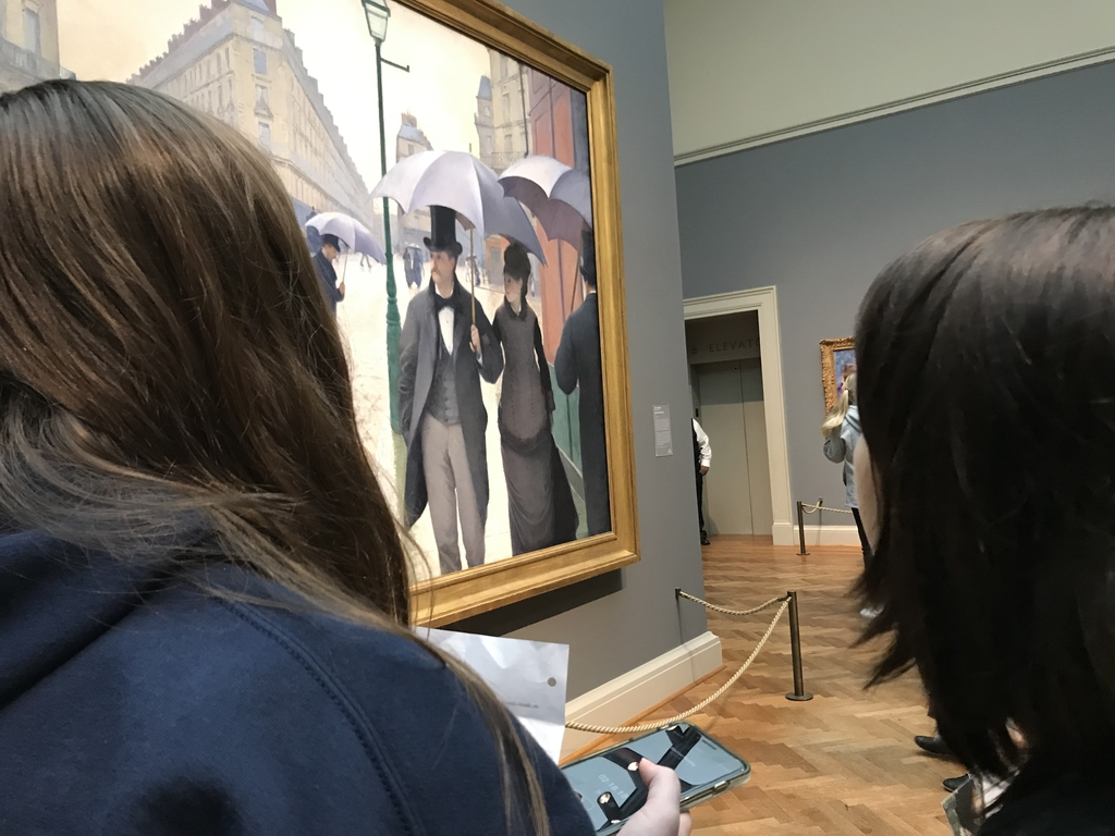 Kim and Maurisa discuss a painting